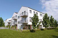 Murowana Goślina z nowymi mieszkaniami