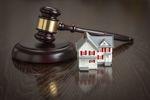 Wygaśnięcie zobowiązania podatkowego: przejęcie nieruchomości