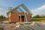 Sprzedaż działki z rozpoczętą budową domu w podatku VAT