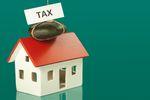 Sprzedaż nieruchomości w ramach firmy a zwolnienie podmiotowe z VAT